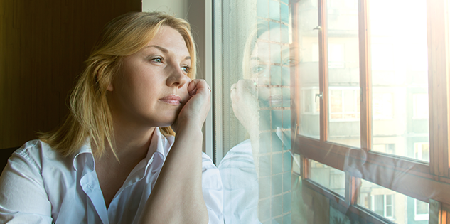 Woman Staring Out of the Window